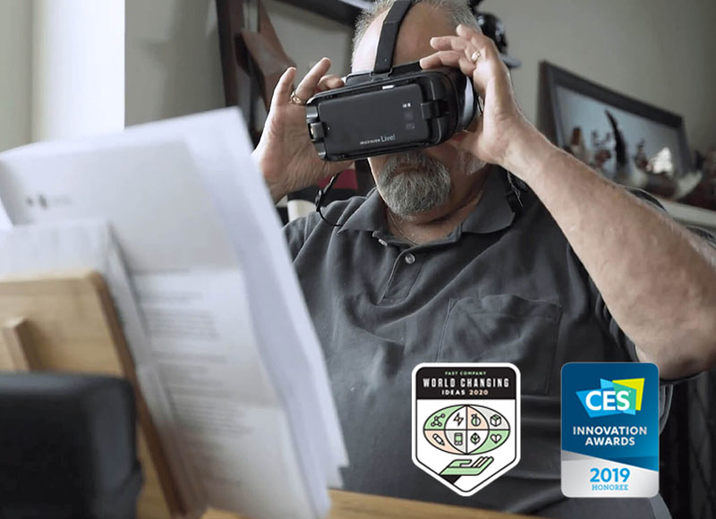 Man Reading news paper while wearing IrisVision